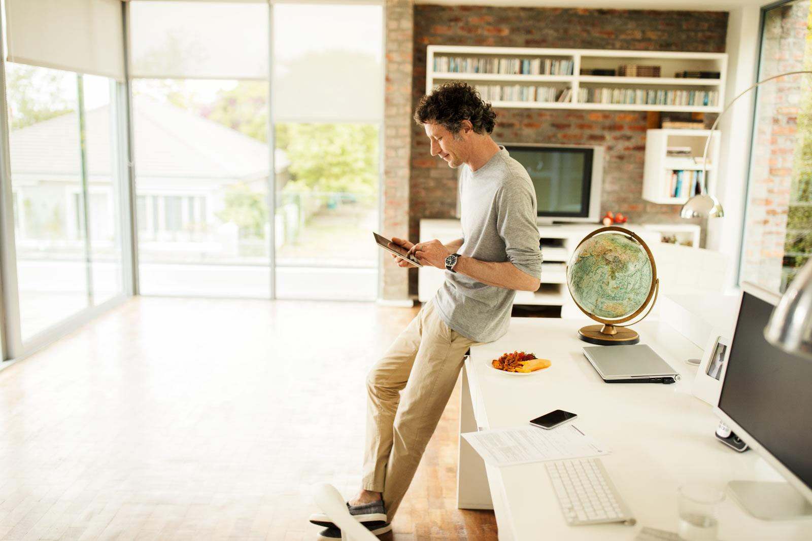 man-with-tablet-standing-in-office